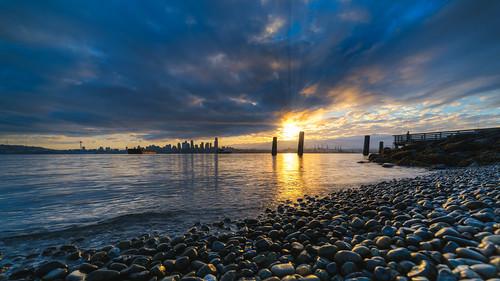 seattle sunrise cityscape elliotbay pugetsound water shore rocks canon canoneos5dmarkiii samyang14mmf28ifedmcaspherical washington johnwestrock