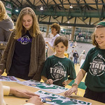 2014-04-01 -- Fans and daughters of coaches, from left, Audrey Rose, Sophia Feeney and Madison Feeney collect autographs from Titan men's basketball players at a celebration for their NCAA semifinal finish.
