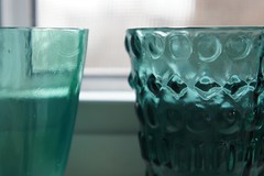 glass bottle(0.0), water(0.0), bottle(0.0), vase(0.0), blue(0.0), alcoholic beverage(0.0), old fashioned glass(1.0), drinkware(1.0), glass(1.0), green(1.0), drink(1.0),
