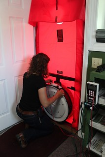 Hope installs the fan in the blower door.