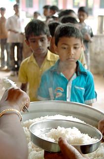 Queueing for lunch - School children in Kerala