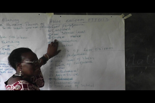 Beatrice Wanyonyi, a teacher at a neighboring primary school, facilitates the Communication and Life-Skills workshop