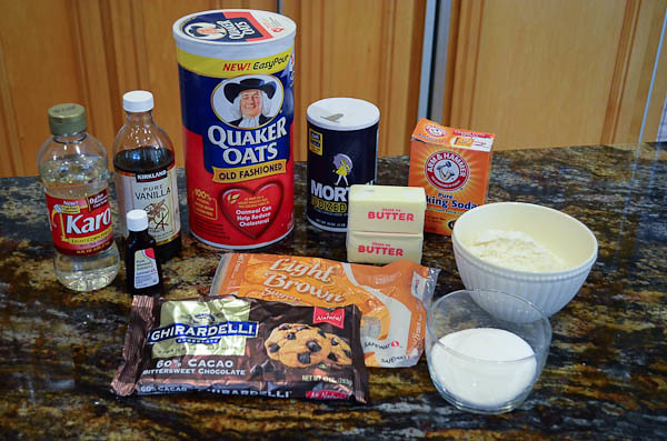 All the ingredients required for Oatmeal-Dark Chocolate Cookie Ice Cream Sandwiches, arranged on a counter top.