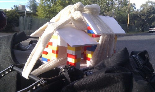 House model tied to bicycle