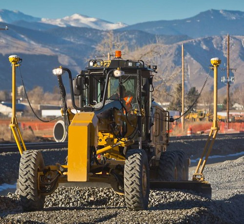 Photo of motor grader working on Gold Line track alignment