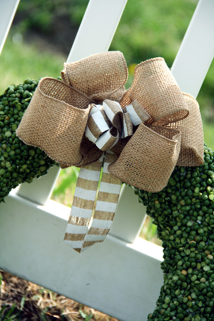 Done_Pea-Wreath-Bow-Against-Fence