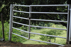 outdoor structure(0.0), home fencing(0.0), chain-link fencing(0.0), garden(0.0), picket fence(0.0), handrail(0.0), fence(1.0), split rail fence(1.0), gate(1.0),