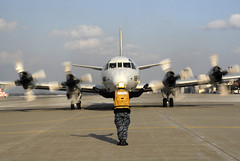 In this file photo, Aviation Electrician's Mate Airman Mark Jimenez, assigned to Patrol Squadron (VP) 1, directs a P-3C Orion at Naval Air Facility Misawa in April 2012. (U.S. Navy photo by Mass Communication Specialist Darrius Wharton)