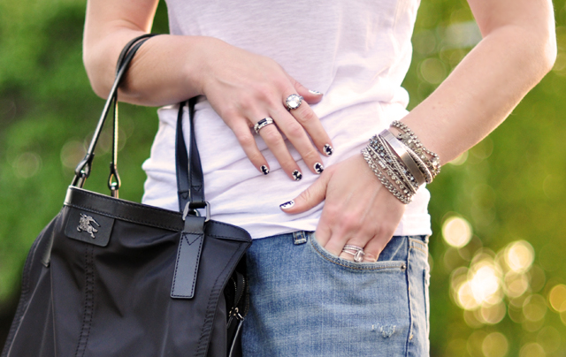 jeans and a white t-silver rhinestone accessories and black bag