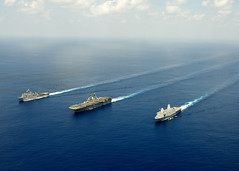 In this file photo, amphibious dock landing ship USS Pearl Harbor (LSD 52), left, amphibious assault ship USS Makin Island (LHD 8), and amphibious transport dock ship USS New Orleans (LPD 18) transit the Indian Ocean, May 8. (U.S. Navy photo by Chief Mass Communication Specialist John Lill)