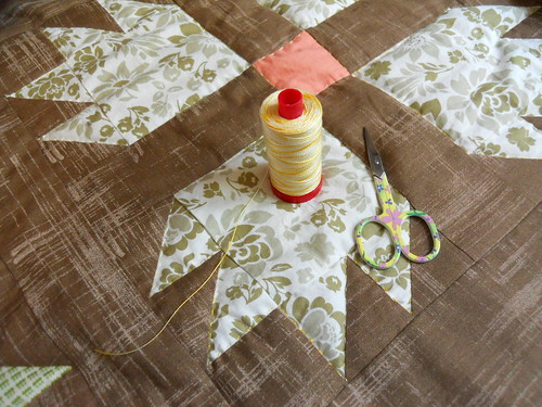 hand quilting with variegated Aurifil 12 wt