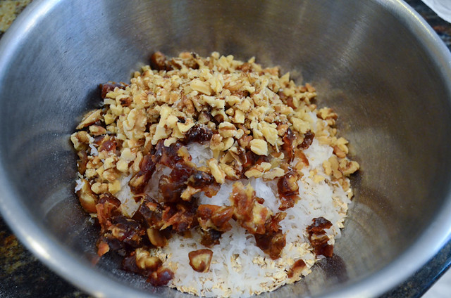 A bowl with oats dates, walnuts, and coconut.