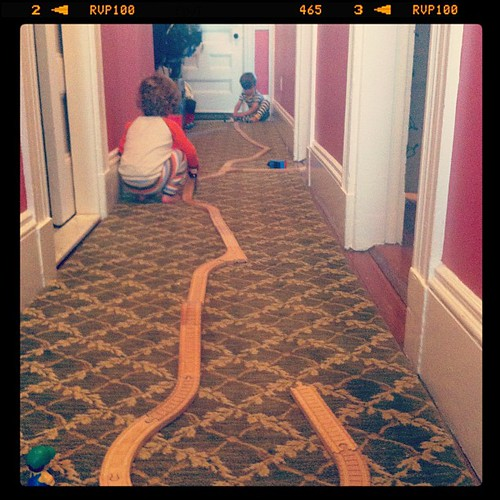 Train track in our hallway...pj's still on...coffee in hand...boys playing together...life is sweet