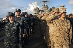 PACIFIC OCEAN (June 4, 2012) Sailors and Marines salute the colors aboard amphibious dock landing ship USS Pearl Harbor (LSD 52) during a commemoration of the 70th anniversary of the Battle of Midway. (U.S. Navy photo by Mass Communication Specialist 2nd Class Jason Behnke)