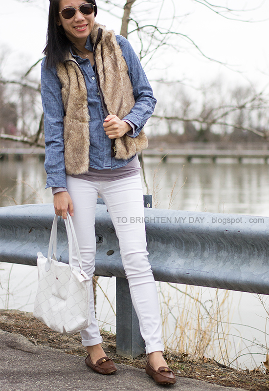 faux fur vest, chambray shirt, white jeans, brown loafers