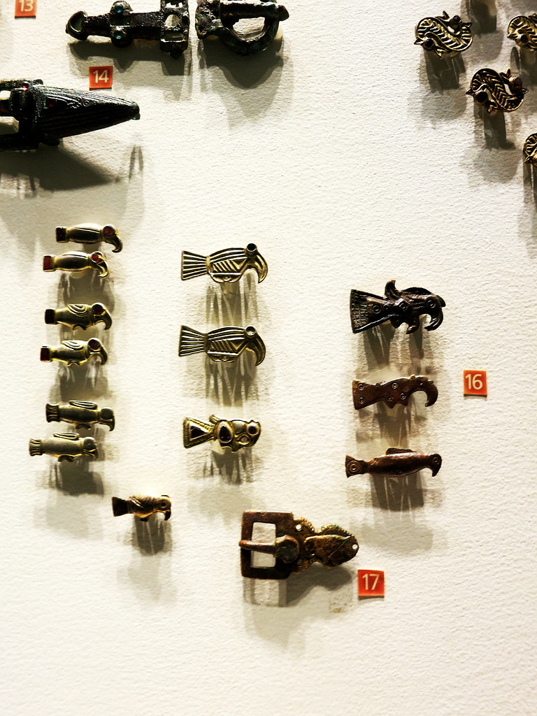 Aviform brooches (end of 5th-beginning of 6th, necropolis of H\xe9rouvillette, Fr\xe8nouville, and Sannerville), and a buckle (6th c. Fr\xe9nouville)