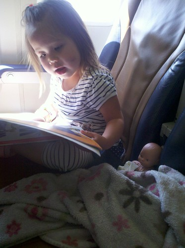 Reading to baby on the plane.