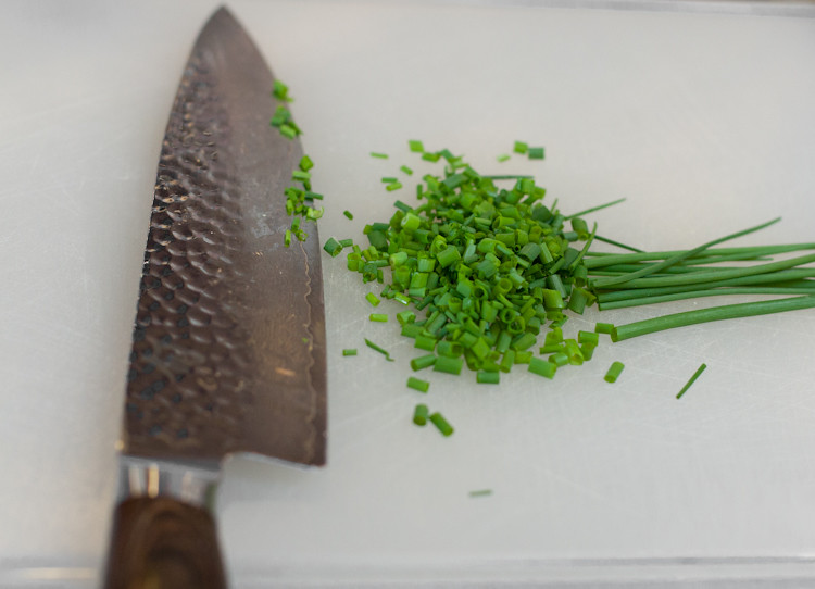 Spring chives, freshly picked and finely diced.  The fragrance is sweet and green.