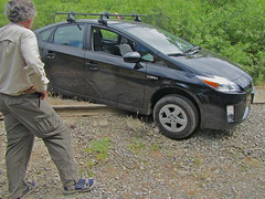 automobile(1.0), automotive exterior(1.0), vehicle(1.0), bumper(1.0), toyota prius(1.0), land vehicle(1.0),