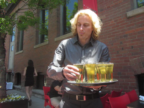the manager at Bier Markt serves Radler samplers to guests