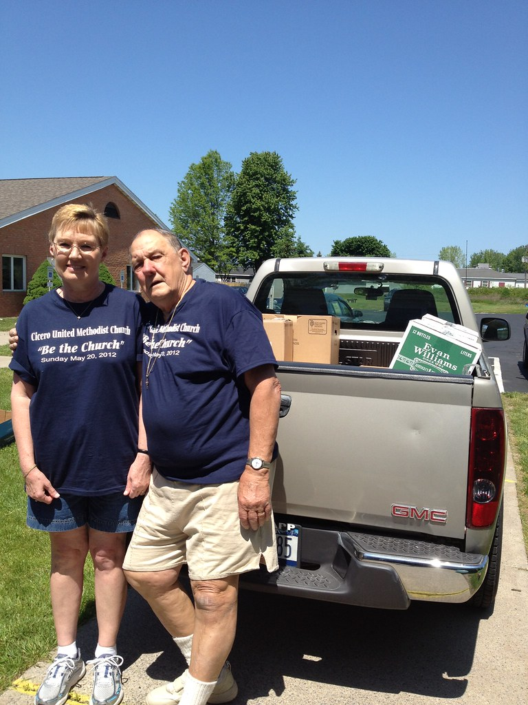 Donnie & her husband in front of a truck full of books donated by the Cicero UMC