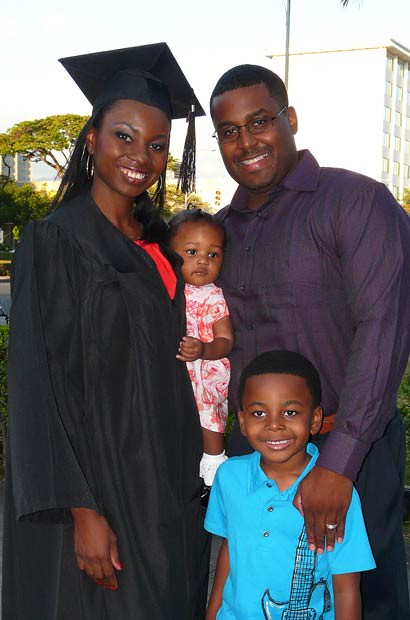 <p>A happy UH West O'ahu graduate with family following commencement exercises on May 12</p>