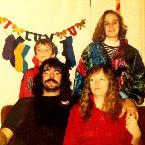 My parents, brother and me, 20+ years ago.