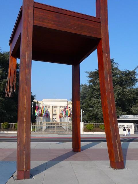broken chair men place des nations gen ve mars 2011 flickr photo sharing. Black Bedroom Furniture Sets. Home Design Ideas