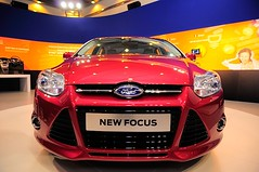 wheel(0.0), world rally car(0.0), automobile(1.0), automotive exterior(1.0), exhibition(1.0), vehicle(1.0), automotive design(1.0), auto show(1.0), ford motor company(1.0), bumper(1.0), ford(1.0), ford focus(1.0), land vehicle(1.0), luxury vehicle(1.0),