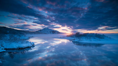 þingvellirnationalpark landscape sunset season nature water reflections nordic suðurland þingvallavatn iceland bláskógabyggð travel cloud magichour frozenlake sky cloudy winter europe lake twilight dusk goldencircle goldenhour halflight lýðveldiðísland republicoficeland southernregion thingfields thingvellir thingvellirnationalpark thingvallavatn ísland þingvellir south