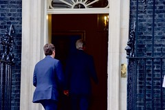 U.S. Secretary of State John Kerry, escorted by Special Adviser to the Prime Minister Nigel Casey, enters No. 10 Downing Street in London, U.K., on June 27, 2016, to speak with Cameron following a meeting with the Secretary's counterpart, British Foreign Secretary Philip Hammond, in the aftermath of last week's 'Brexit' vote by the British people. [State Department Photo/ Public Domain]