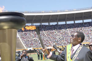 Republic of Zimbabwe President Robert Mugabe lights the torch commemorating the 32nd anniversary of national independence of this Southern African nation. Zimbabwe won its freedom from British imperiaism in 1980. by Pan-African News Wire File Photos
