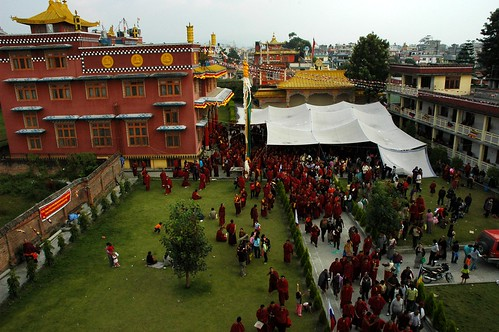 Tibetan Buddhists from above coming out of a transmission, mostly monks, laity, tents, Lamdre, Tharlam Monastery courtyard, Tibetan Buddhism, Boudha, Kathmandu, Nepal by Wonderlane