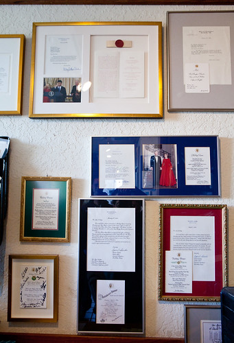 Wall full of White House dinner menus that featured Iron Horse Vineyards' wine