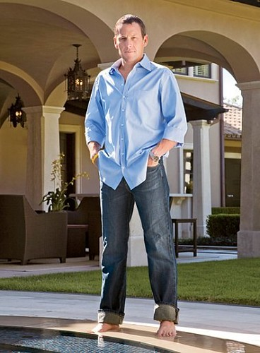 lance armstrong in front of wicker patio furniture