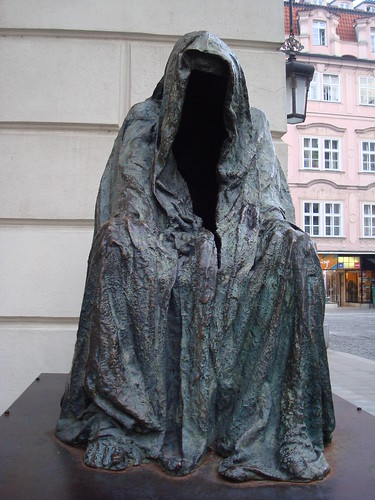 "The haunting hooded figure in Prague is labeled ""Il Commendatore,"" from Mozart's Don Giovanni."