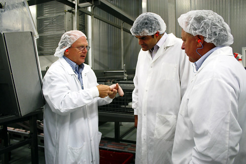 Rural Business and Cooperative Programs Acting Administrator, John Paladino (center), tours Salm Partners, LLC, a sausage manufacturer, in Demark, WI, with Chris Salm, (left) owner, and Stan Gruszynski (right), Wisconsin Rural Development State Director.  Salm Partners, LLC partners with a number of local and regional producers and suppliers.
