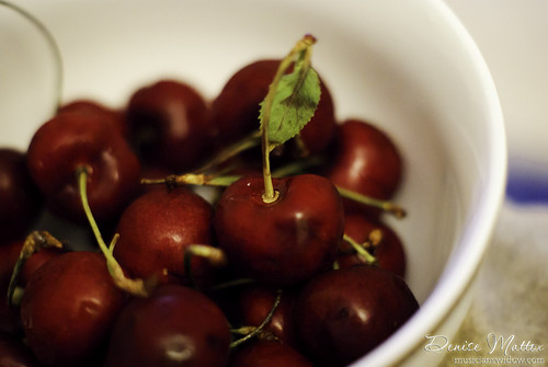 266: A bowl full of cherries