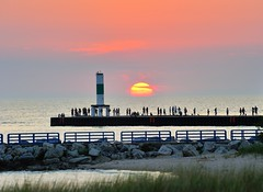 Holland Harbor Sunset - Holland, Michigan Breakwater Light by Michigan Nut
