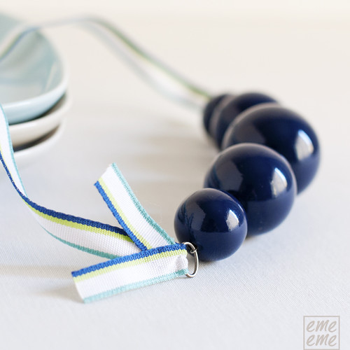 Necklace dark blue wooden beads and striped ribbon