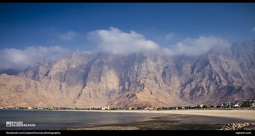 blue sea sky mountains water clouds oman musandam