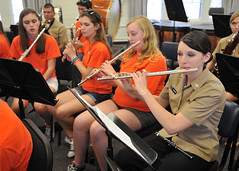 Musician 3rd Class Abbie Johnson plays alongside members of the Vacaville High School band (U.S. Navy/MC1 David Kolmel)