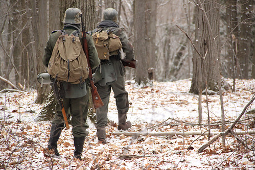 Lead actors Miles Crosman '12 and Eric Schaum '15 trudge through the woods on the set of Der Kampf.