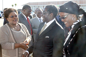 Zimbabwe President Robert Mugabe and First Lady Grace Amai with Vice President Joice Mujuru at Harare International Airport as the president leaves the country for Malawi. They will attend the burial of the late President Bingu wa Mutharika. by Pan-African News Wire File Photos