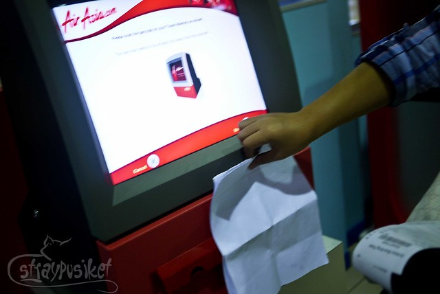 scan your ticket at Air Asia Self Check In Kiosk