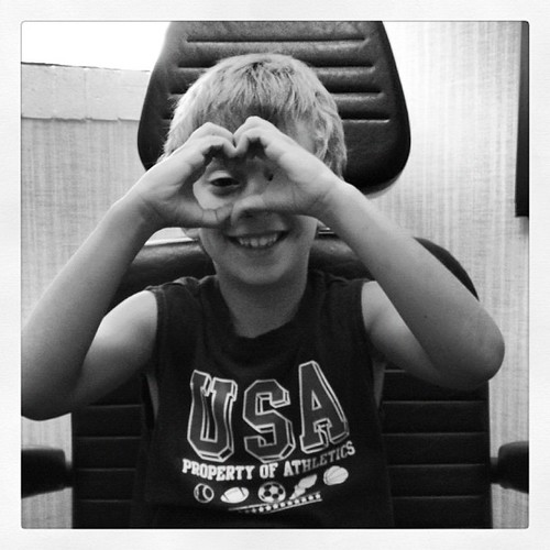 JPAD: 25: heart. Alex making a heart with his hands while waiting for the doctor. He has an ear infection.
