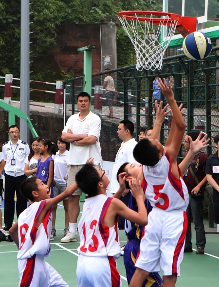 August 24th, 2012 - Yao Ming watches basketball players at a basketball camp in Sichuan