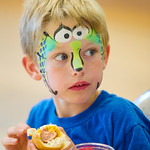 12-043-6 -- Zander Tichenor, 7-year-old son of Natural Sciences Senior Office Coordinator Stacey Tichenor, sports some imaginative face paint while enjoying a hot dog.