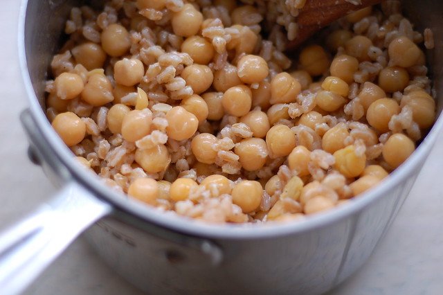Mixing the farro and chickpeas with garlic, olive oil, lemon juice and salt by Eve Fox, the Garden of Eating, copyright 2016