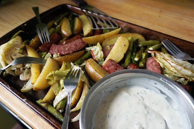 Roasted vegetables and sausage with herbed yogurt sauce: the same scene at the top of the post, but now shot from an oblique angle so everything looks angular and intriguingly offkilter.